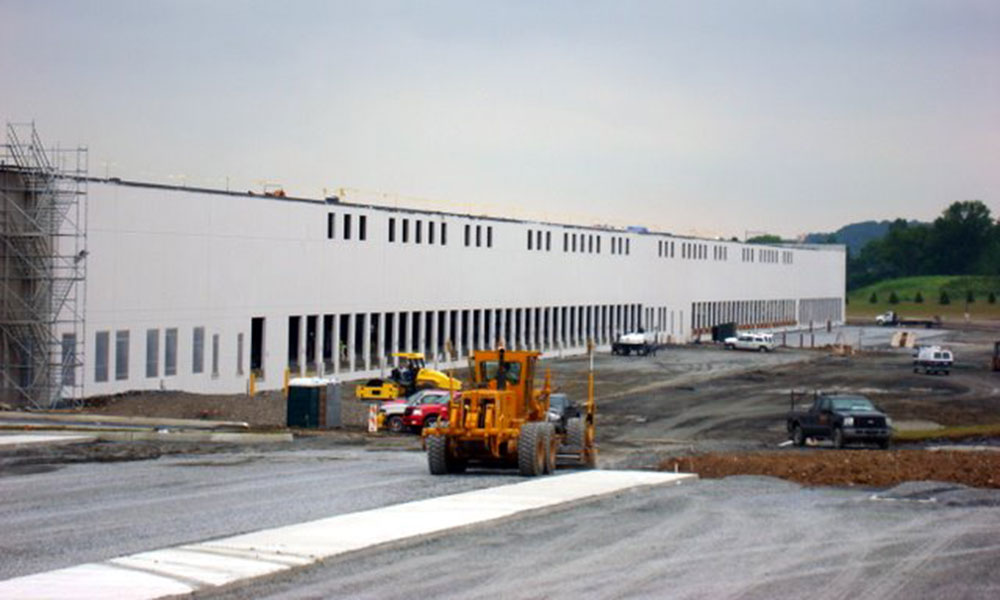 warehouse exterior under construction with equipment