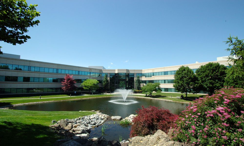 Chesterbrook Corporate Center wide angle full exterior view with fountain in front of the building
