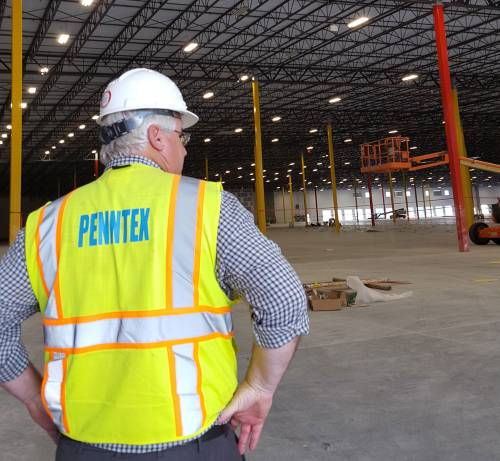 Penntex team member inside an under construction facility